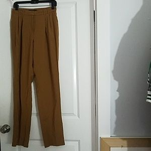 Brown trousers with hook/eye button closure